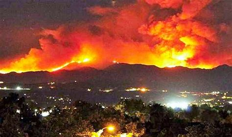 Hundreds evacuated as OUT OF CONTROL wildfire engulfs
