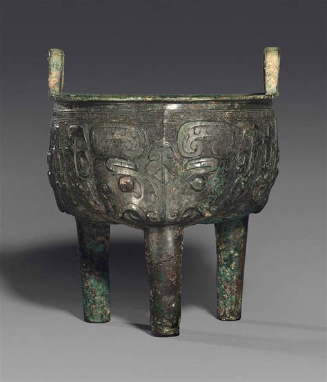 A BRONZE TRIPOD VESSEL, DING , LATE SHANG DYNASTY (1600